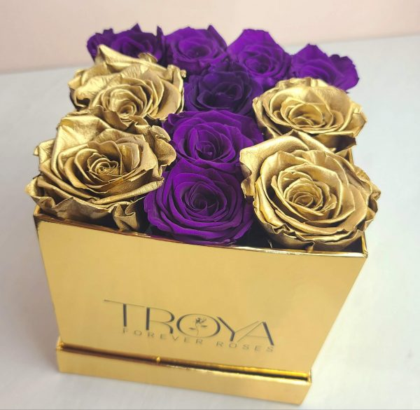 Gold and purple forever roses ina box
