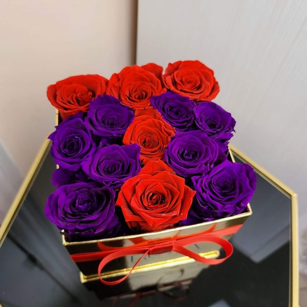 Red and purple forever roses in a box