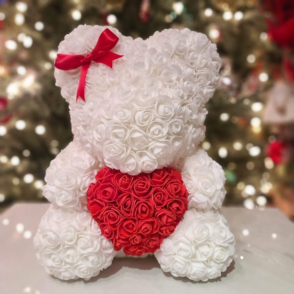 White rose bear with a bow