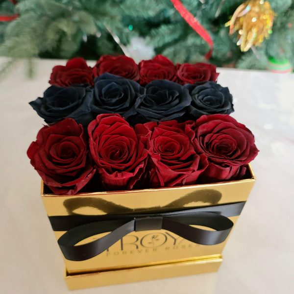 Maroon & black forever roses in gold box