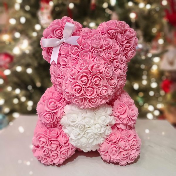Pink rose bear with a bow