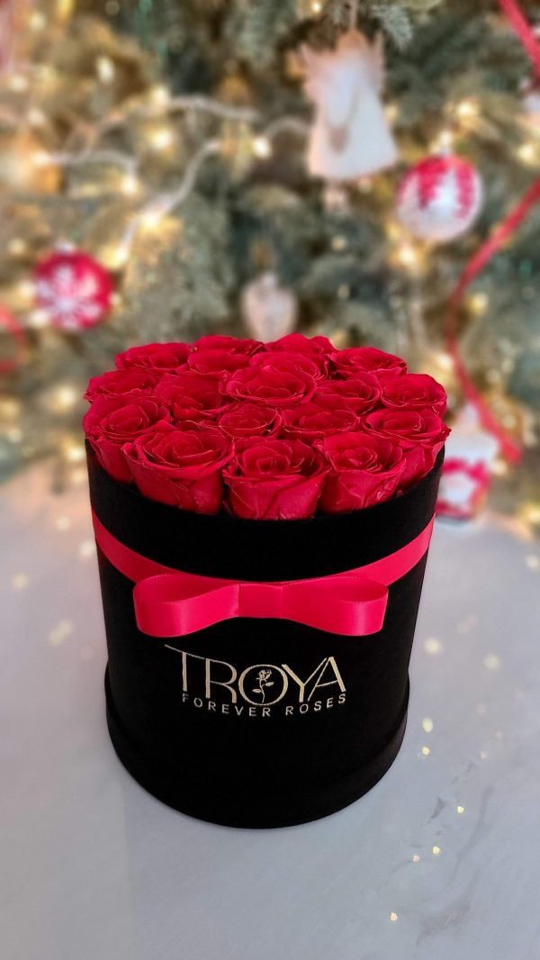 Red forever roses in small round black box
