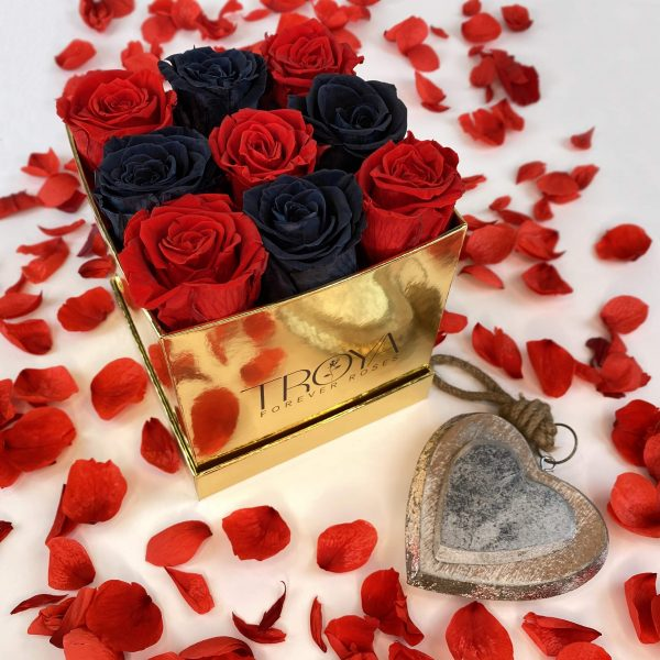 Red & black forever roses in gold box