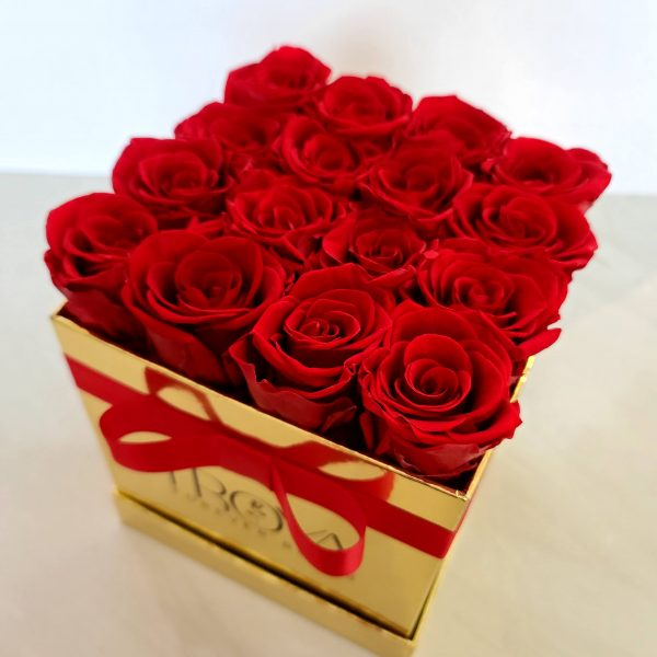 Square gold box with red forever roses