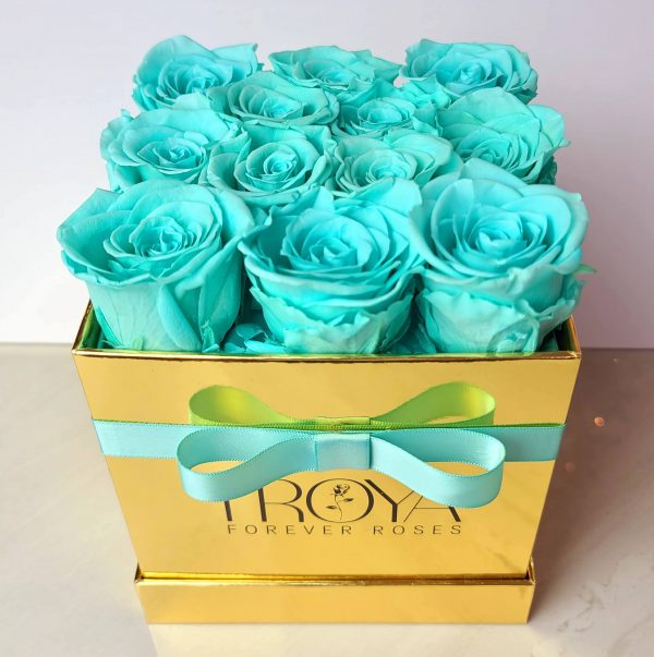 Teal forever roses in a gold box